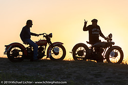Cole Deister and race director Jason Sims check out the sunset from above Jason's house in Sturgis after riding antique Harley-Davidsons on the one rest day of the Motorcycle Cannonball coast to coast vintage run. Rest day in Sturgis, SD. Monday September 17, 2018. Photography ©2018 Michael Lichter.