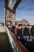 Tourists on Tower Bridge London. This is one of the most popular destinations in the capital.