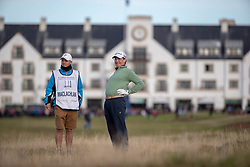Actor Kyle McLachlan stretches as he waits to play his second shot from the thick rough after slicing his tee shot at the 17th hole during day two of the Alfred Dunhill Links Championship at Carnoustie Golf Links, Angus.