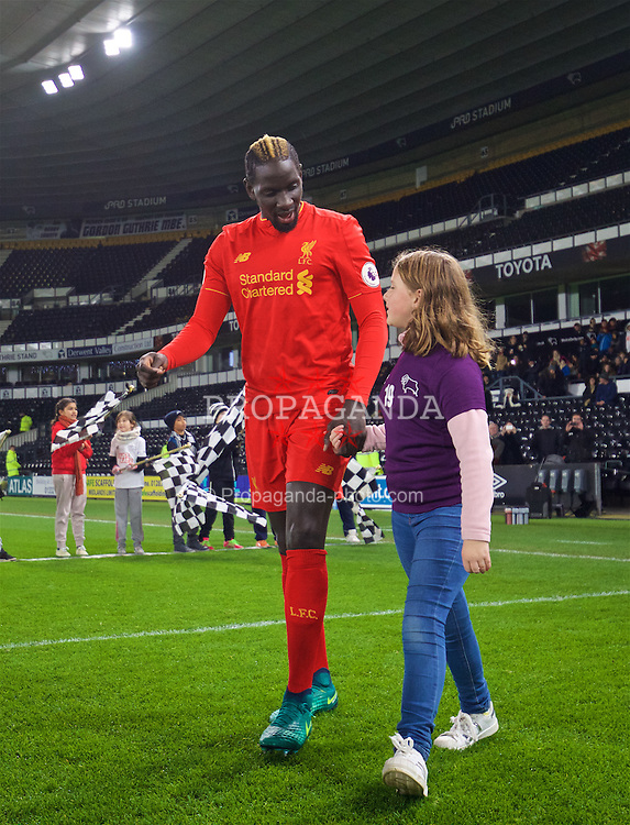 DERBY, ENGLAND - Monday, November 28, 2016: Liverpool's Mamadou Sakho walks out with a mascot before the FA Premier League 2 Under-23 match against Derby County at Pride Park. (Pic by David Rawcliffe/Propaganda)