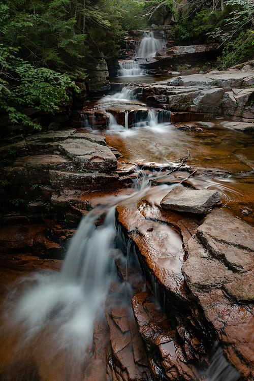 Mountain water sliding down through Bemis Brook Falls.