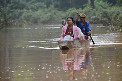 July 26, 2018 - Attapeu, Laos - Villagers row a boat in flood after an under-construction dam collapsed in Attapeu province. At least 26 people have reportedly died and more than 100 are missing. An estimated 25,000 people are being evacuated. The under-construction Xepian-Xe Nam Noy hydropower dam collapsed on Monday, triggering flash flood in seven villages of Sanamxay district, in Laos'southern Attapeu province.   (Credit Image: © Liu Ailun/Xinhua via ZUMA Wire)