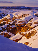 Warm glow of sunset illuminating the top of Inscripton Rock, El Morro National Monument, New Mexico.