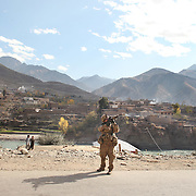 Unloading and approaching the village of Nari to give a class to Afghan women on setting up water filtration systems, Kunar Province of Eastern Afghanistan.