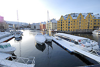 Alesund Harbor in Winter. Image taken with a Nikon D2xs and 12-24 mm f/4 lens (ISO 100, 12 mm, f/6, 1/160 sec).