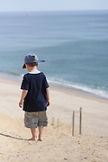 A five-year-old boy walks barefoot down a dune to Cahoun Hollow Beach on the Cape Cod National Seashore, Wellfleet, Massachusetts.