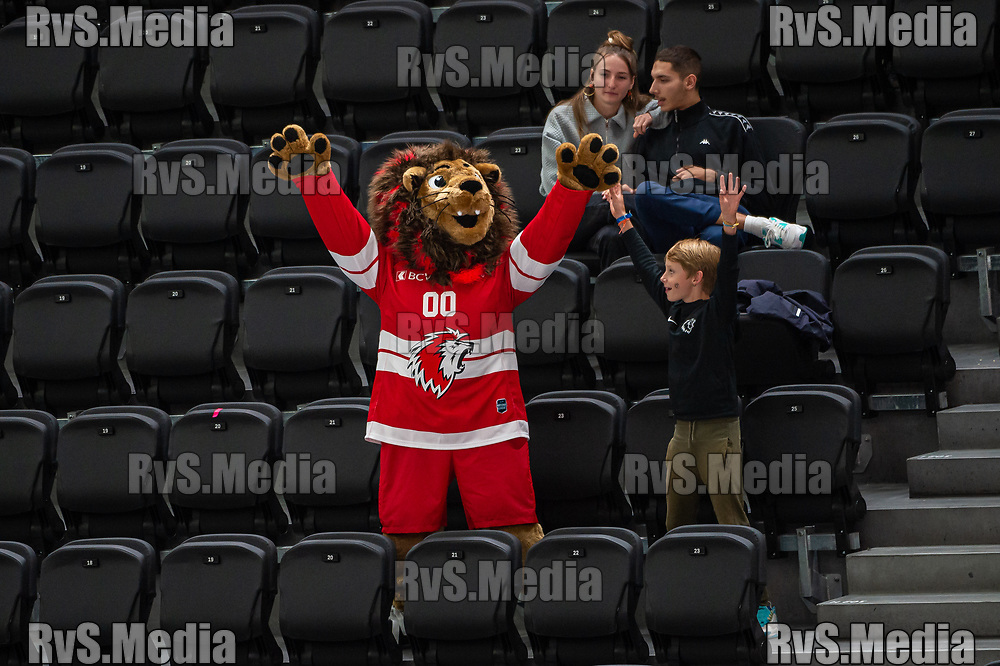 LAUSANNE, SWITZERLAND - SEPTEMBER 24: Mascot Leo cheers with fans during the Swiss National League game between Lausanne HC and HC Davos at Vaudoise Arena on September 24, 2021 in Lausanne, Switzerland. (Photo by Robert Hradil/RvS.Media)