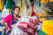 09 OCTOBER 2012 - BANGKOK, THAILAND:  A vendor in the Bangkok Flower Market. The Bangkok Flower Market (Pak Klong Talad) is the biggest wholesale and retail fresh flower market in Bangkok. It is also one of the largest fresh fruit and produce markets in the city. The market is located in the old part of the city, south of Wat Po (Temple of the Reclining Buddha) and the Grand Palace.    PHOTO BY JACK KURTZ