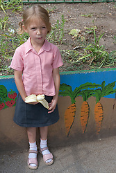Little girl eating a banana,