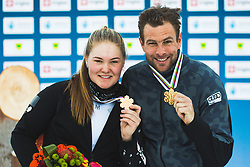 Sofia Nadyrshina (RSF) with Benjamin Karl (AUT) during medal ceremony after parallel slalom FIS Snowboard Alpine World Championships 2021 on March 2nd 2021 on Rogla, Slovenia. Photo by Grega Valancic / Sportida