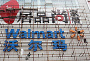 Two construction workers climb a scaffolding outside the entrance of an unfinished Wal-Mart store in Guilin, Guangxi Province, China on September 09, 2009. Walmart is increasing its presence in China's smaller cities to tap into the vast consumer base of China's interior.