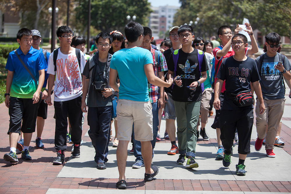 A tour is led in a foreign language to prospective students at USC.