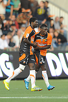 FOOTBALL - FRENCH CHAMPIONSHIP 2010/2011 - L1 - FC LORIENT v OLYMPIQUE LYONNAIS - 28/08/2010 - PHOTO PASCAL ALLEE / DPPI -  JOY LYNEL DARCY KITAMBALA (FCL) ATHER HIS GOAL. HE IS CONGRATULATED BY BRUNO ECUELE MANGA