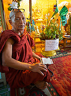 An old monk inside a temple. Monks are expected to fulfill a variety of roles in the Buddhist community. First and foremost, they are expected to preserve the doctrine and discipline known as Buddhism.