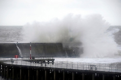© Licensed to London News Pictures. 11/12/2014. Aberystwyth, UK Severe gales and big waves continue to batter the coast at Aberystwyth for a second day as the 'weather bomb' of low pressure works its way southwards across the UK. Photo credit : Keith Morris/LNP