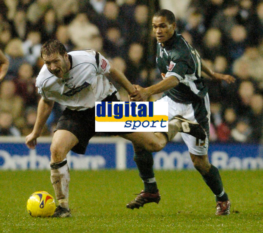 Photo: Leigh Quinnell.<br /> Derby County v Plymouth Argyle. Coca Cola Championship. 30/12/2006. Derbys Steve Howard is brought to ground by Plymouths Matthias Doumbe.