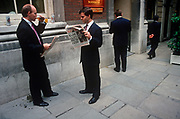 A businessman reads a 1992 edition of the Daily Express whose headline announces that Prime Minister John Major is fighting the Pound Crisis, on a bench in the City of London (aka The Square Mile), the capital's financial centre, on 18th September 1992, in London, England. Black Wednesday occurred in the United Kingdom on 16 September 1992, when John Major's Conservative government was forced to withdraw the pound sterling from the European Exchange Rate Mechanism (ERM) after it was unable to keep the pound above its agreed lower limit in the ERM. (Photo by Richard Baker / In Pictures via Getty Images)