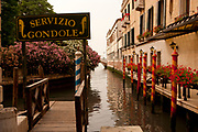 Unique gondola dock on a canal, Venice Italy