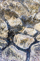 Pillow lavais named this because of the pillow shapes attributed to the lava having been exposed underwater.  They are characterized by masses created whenmagmareached the surface but becvause the difference in temperatures between the lava and the water, the surface cooled very quickly which formed a skin. This process produced interconnecting shapes that look like  pillows in appearance.  They are classified as bulbous, spherical or tubular lobes of lava.
