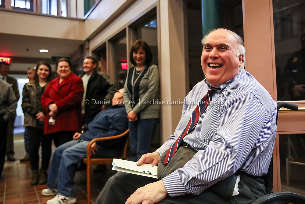 (3/23/15, MILFORD, MA) Dino DeBartolomeis', a selectman for 33 years, has a laugh with well-wishers before his last meeting at Milford Town Hall on Monday. Daily News and Wicked Local Photo/Dan Holmes