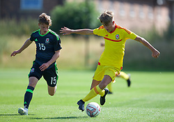 WREXHAM, WALES - Monday, July 22, 2019: Jensen Livick of South and Caio Inch of North during the Welsh Football Trust Cymru Cup 2019 at Colliers Park. (Pic by Paul Greenwood/Propaganda)
