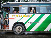 14 JUNE 2013 -  SAMALAUK, AYEYARWADY, MYANMAR:  Passengers on a long distance bus on Highway 5 in Samalauk, Ayeyarwady, in the Irrawaddy delta region of Myanmar. Most Burmese men join the clergy at least once in the lives, sometimes for just a few weeks, other times for a lifetime commitment. This region of Myanmar was devastated by cyclone Nargis in 2008 but daily life has resumed and it is now a leading rice producing region.  PHOTO BY JACK KURTZ