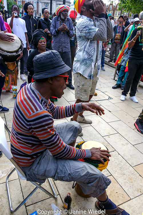 Man  drumming of Groundation music at annual Reparations Rebellion event on Afrikan Emancipation Day in Windrush Square Brixton 2021.