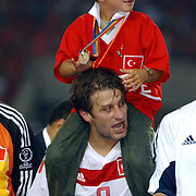 Turkey's Kerimoglu Tugay with his son at the third place victory ceremony
