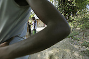 With 2/3 of the population unemployed, youngsters are often left with no options.  Two youngsters listen to their battery operated radio in front of their home high on the mountainside above Carrefour, Haiti.  Over 80% of Haiti's 10 million residents live in poverty, and its youth are left to ponder their bleak future.