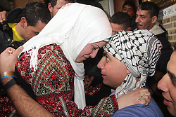 60875569<br /> A newly released Palestinian prisoner (R) hugs his sister upon his arrival in the southern Gaza Strip city of Khan Yonis, on Dec. 31, 2013. Israel freed 26 Palestinian prisoners early Tuesday, as part of a U.S.-brokered agreement to resume direct peace talks between the two sides, Tuesday, 31st December 2013. Picture by  imago / i-Images<br /> UK ONLY