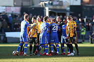 Robbie Willmott of Newport County (2nd left) holds his shirt after he was spat on by Samual Saiz of Leeds Utd (hidden in middle)  late in the match, leading to all the players getting involved in a scuffle and a red card for Leeds player Samual Saiz for spitting at Willmott. Emirates FA Cup , 3rd round match, Newport county v Leeds Utd at Rodney Parade in Newport, South Wales on Sunday 7th January 2018.<br /> pic by Andrew Orchard,  Andrew Orchard sports photography.