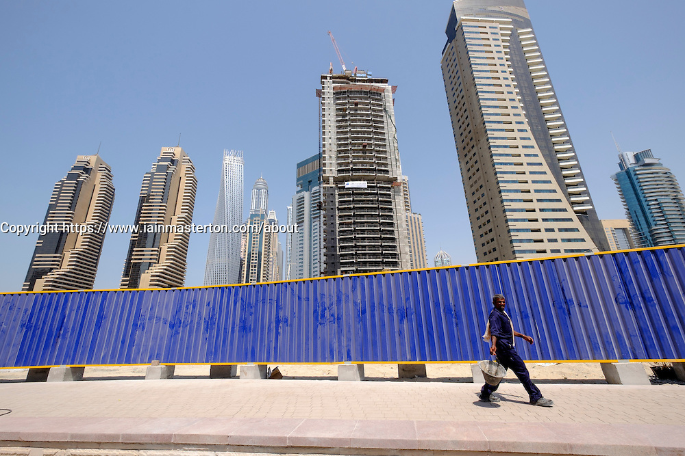 Skyline of skyscrapers under construction in Marina district of Dubai United Arab Emirates