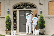Workers secure plywood covering on a historic home in preparation for Hurricane Irma September 8, 2017 in Charleston, South Carolina. Imra is expected to spare the Charleston area but hurricane preparations continue as Irma leaves a path of destruction across the Caribbean.