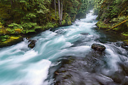 The ice-blue waters of Oregon's McKenzie River cascade over Sahalie Falls.
