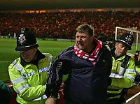Photo: Jed Wee.<br /> Middlesbrough v FC Basle. UEFA Cup. Quarter-Final. 06/04/2006.<br /> <br /> Police lead off a pitch invader.