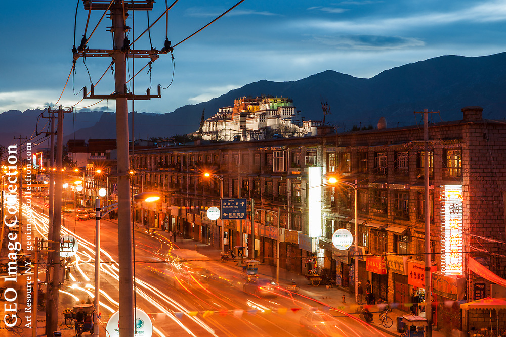 Viewed from the city of Lhasa, with its telephone lines, electric lights and traffic, the Potala Palace is brought back into the focus of modern Chinese life. Tibet