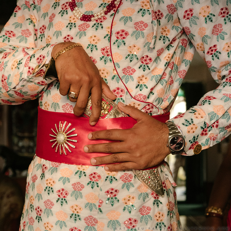 The groom gets ready at his home,  before walking to the bride's family in a parade called Janti.