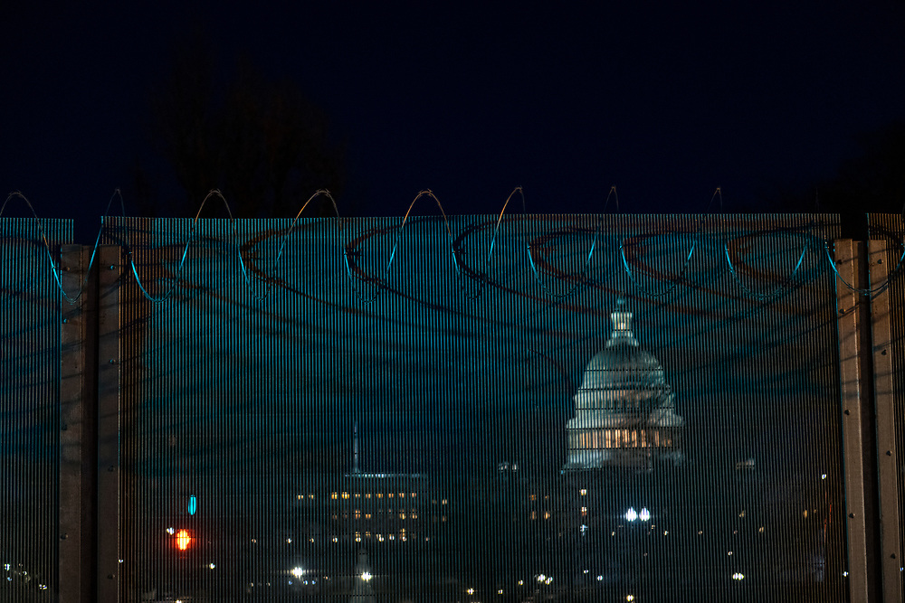 Coils of razor wire stretch along the top of a fence constructed days earlier around the U.S. Capitol Building in Washington D.C.
