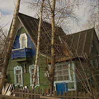An abandoned Russian house falls apart by a road leading into the northern port of Arkhangel'sk.