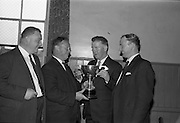 30/7/1964<br /> 7/30/1964<br /> 30 July 1964<br /> <br /> Presentation of the Beamish cup at the C.I.E. Luncheon <br /> Mr. Martin Ryan(2nd From the Left) the Senior rep from Beamish and Crawford presenting the Beamish Cup to Patrick Hughes the Captain Carew's Dart Team. Also attending Mr. Peter McGlynn the ublin District Manager from Beamish and Crawford on the left and Mr. William Fitzsimmons Sec. of the National Dart League on the Right