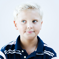 portrait of a smart caucasian expressive kid on idoor isolated background