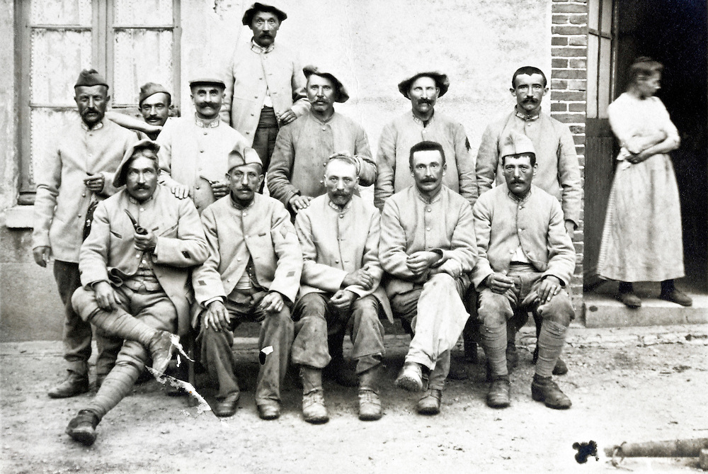group portrait French soldiers during a rest break from fighting 1910s