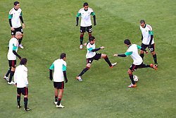 Team of Mexico at warming up prior to the kick-off of the Group A first round 2010 FIFA World Cup South Africa match between South Africa and Mexico at Soccer City Stadium on June 11, 2010 in Johannesburg, South Africa.  (Photo by Vid Ponikvar / Sportida)