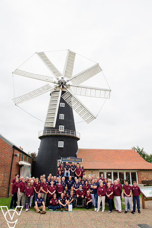Two volunteer groups from Heckington in Lincolnshire have been awarded the Queen's Award for Voluntary Services.  Pictured are the teams of volunteers from Heckington Windmill and the Heckington Show who have been celebrating receiving the award.<br /> <br /> Picture: Chris Vaughan Photography<br /> Date: June 9, 2018