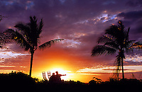 Couple watching sunset, Maul'aka Beach, Makena, Maui, Hawaii