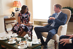 """First Lady Michelle Obama meets with Prince Harry for tea to discuss the """"Let Girls Learn"""" initiative and support for veterans, at Kensington Palace in London, England, June 16, 2015. (Official White House Photo by Amanda Lucidon) <br /> <br /> This official White House photograph is being made available only for publication by news organizations and/or for personal use printing by the subject(s) of the photograph. The photograph may not be manipulated in any way and may not be used in commercial or political materials, advertisements, emails, products, promotions that in any way suggests approval or endorsement of the President, the First Family, or the White House."""