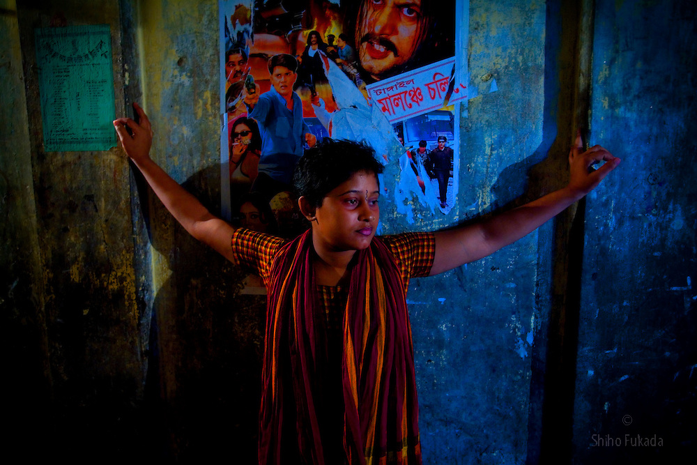 Sex worker Lima, 18, waits for customer at brothel, June 28, 2007 in Tangail, Bangladesh. Born into a poor family, she was lured to a false job offer at a garment factory but instead was sold to brothel when she was 13 years old. <br /> The majority of the 20,000 to 30,000 female sex workers in Bangladesh are victims of trafficking. <br /> Once they enter the brothel, usually before the age of 12, they are generally in for life because of social stigma and poverty.