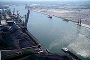 Nederland, Amsterdam, Westhaven, 17/05/2002; Westelijke havengebied - Jan Riebeeckhaven met links OBA BULK TERMINAL AMSTERDAM (kolen, ertsen, mineralen, schroot, agribulk); rechts de terminal van NIssan met terrrein van geimporteerde auoto's; overslag scheepvaart economie bedrijvigheid industrie Noordzeekanaal; Western port - Jan Riebeeck Haven with links OBA BULK TERMINAL AMSTERDAM (coal, ores, minerals, scrap, agricultural bulk); right into the terminal with Nissan of terrrein auoto imported cars, handling shipping industry economics;<br /> luchtfoto (toeslag), aerial photo (additional fee)<br /> foto /photo Siebe Swart