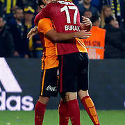 Galatasaray's Olcan Adin (L) and Burak Yilmaz (R) during their Turkish super league soccer derby Fenerbahce between Galatasaray at the Sukru Saracaoglu stadium in Istanbul Turkey on Sunday 25 October 2015. Photo by Kurtulus YILMAZ/TURKPIX