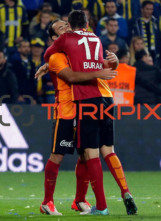 Galatasaray's Olcan Adin (L) and Burak Yilmaz (R) during their Turkish super league soccer derby Fenerbahce between Galatasaray at the Sukru Saracaoglu stadium in Istanbul Turkey on Sunday 25 October 2015. Photo by Kurtulus YILMAZ/TURKPIX